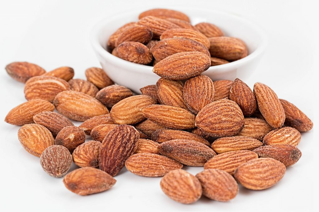 wine and healthy snacks almonds